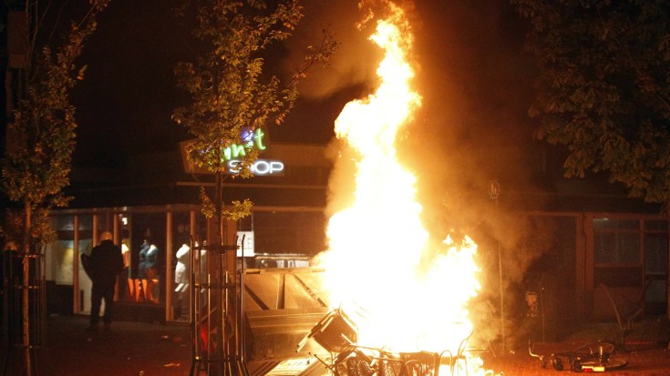 File photo - Chairs burn in the northern Dutch town of Haren late on Sept. 21, 2012 as riot police went into action to contain thousands of party-goers who turned up after a teenager's birthday invite on Facebook went viral. (CATRINUS VAN DER VEEN/AFP/GettyImages)