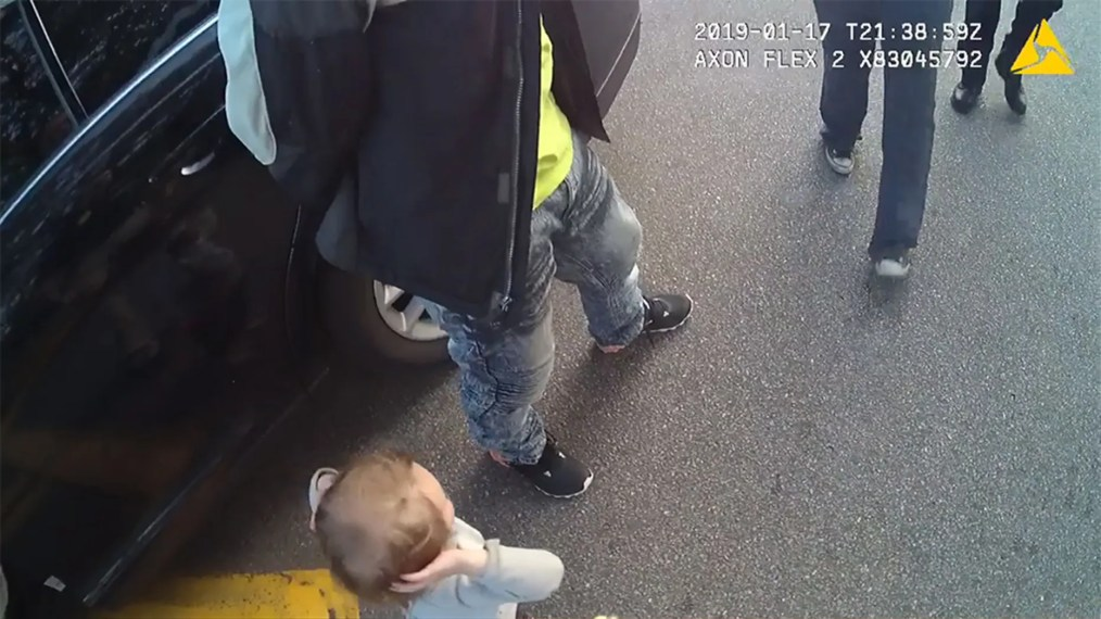 Image from a police body camera showing a 2-year-old girl walking towards officers in Tallahassee, Fla., with her hands in the air. Police said the child was imitating her parents at the time.