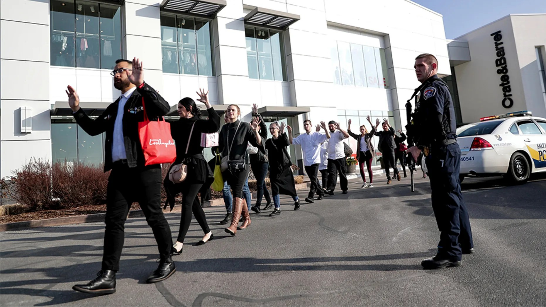 People evacuate after a reported shooting at Fashion Place Mall in Murray, Utah on Sunday, Jan. 13, 2019. (Spenser Heaps/The Deseret News via AP)
