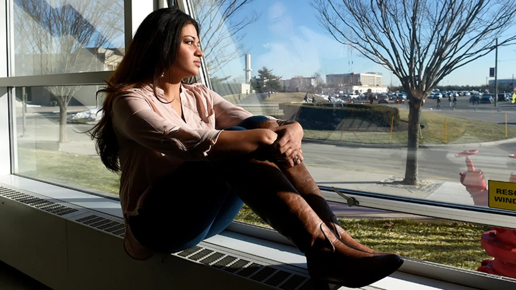 In this Feb. 2, 2016, file photo, Naila Amin, 26, looks out from a classroom window at Nassau Community College in Garden City, N.Y.