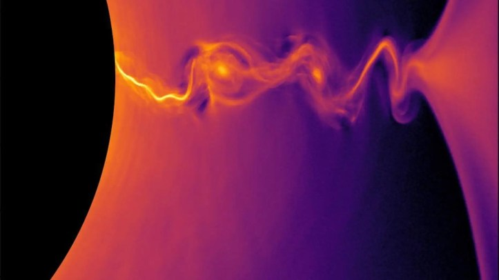 A new computer model captures the twisting lines of plasma jets that stream out from the edges of a black hole. Here, a simulation of so-called collisionless relativistic plasma shows the density of positrons, or antimatter partners to electrons, near a rotating black hole.