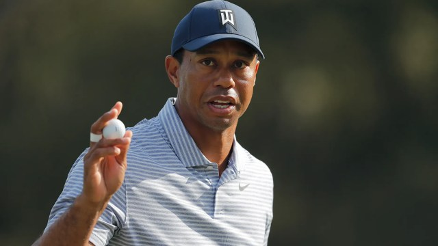 Tiger Woods holds up his golf ball after putting out on the 14th hole during the second round of The Players Championship golf tournament Friday, March 15, 2019, in Ponte Vedra Beach, Fla. (Associated Press)