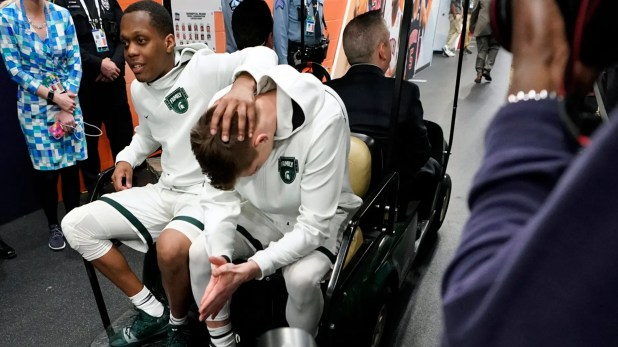 Cbadius Winston of Michigan State, left, and Matt McQuaid react after the team's 61-51 loss to Texas Tech. (AP Photo / David J. Phillip)