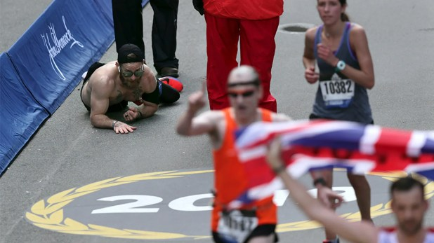 Micah Herndon, a Marine who served in Iraq and Afghanistan, crawled through the final line of the Boston Marathon on Monday.