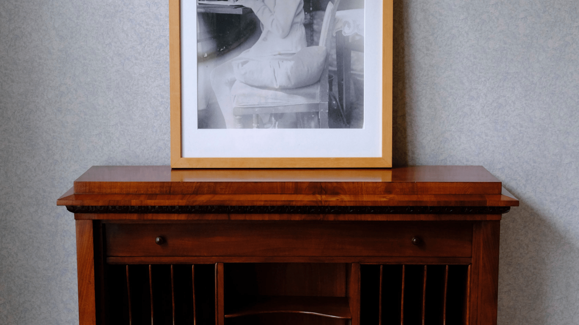 A photo of Anne Frank stands on a replica of the writing desk she once used in her family's former apartment in Amsterdam, during an event to mark what would have been Anne Frank's 90th birthday, in Amsterdam, Netherlands, Wednesday, June 12, 2019. On the day Anne Frank would have turned 90, the museum dedicated to keeping alive her story has brought together schoolchildren and two of the Jewish diarist's friends at the apartment where she lived with her family before going into hiding from Nazis who occupied the Netherlands during World War II. (AP Photo/Michael C. Corder)