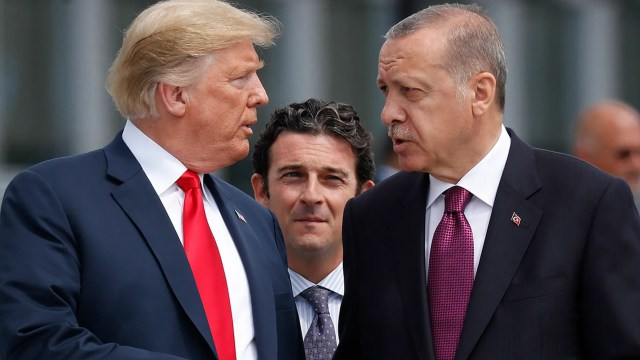 FILE 2018: President Donald Trump, left, talks with Turkey's President Recep Tayyip Erdogan, as they arrive together for a family photo at a summit of heads of state and government at NATO headquarters in Brussels. (AP Photo/Pablo Martinez Monsivais, File)