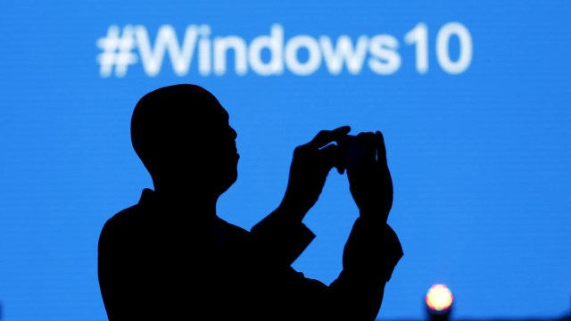 A Microsoft delegate takes a picture during the launch of the Windows 10 operating system in Kenya's capital Nairobi, July 29, 2015 - file photo.