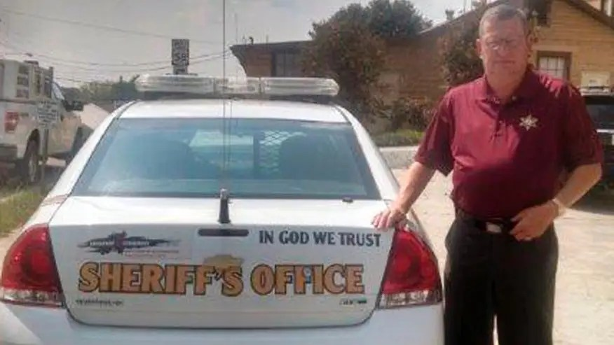 U.S. New Plus — Police cars' 'In God We Trust' decals draw...