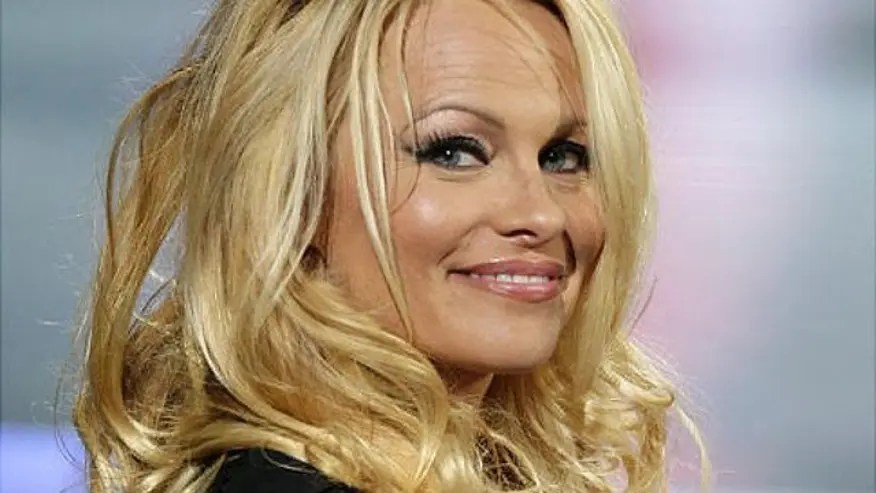 Pamela Anderson bares ALL one last time on the cover of