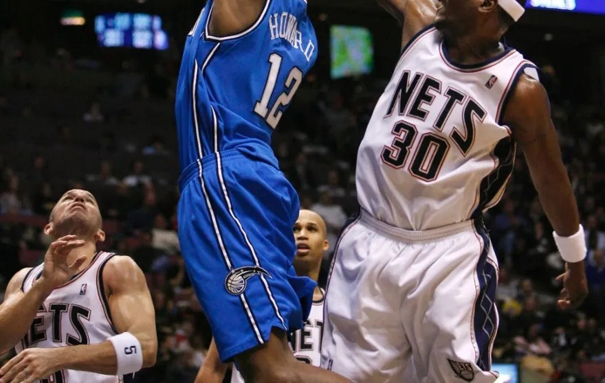 New Jersey Nets forward Cliff Robinson blocks a shot by Orlando Magic center Dwight Howard