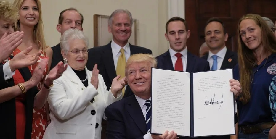 President Donald Trump holds up a signed executive order during an event on Apprenticeship and Workforce of Tomorrow initiatives, Thursday, June 15, 2017, in the Roosevelt Room of the White House in Washington. He is joined by, from second from left, daughter Ivanka Trump, Rep. Virginia Foxx, R-N.C., Labor Secretary Alexander Acosta and South Carolina Gov. Henry McMaster. (AP Photo/Susan Walsh)