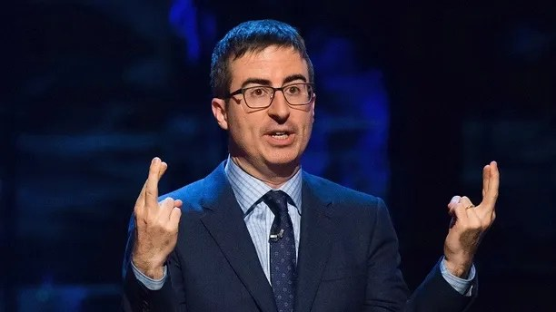"""FILE - In this Feb. 28, 2015, file photo, John Oliver speaks in New York. Coal company Murray Energy is suing HBO and its Sunday-night host, John Oliver, for what it says was a """"false and malicious broadcast."""" Oliver's 24-minute """"Last Week Tonight"""" coal segment on Sunday, June 18, 2017, criticized the Trump's administration effort to revive the industry and ribbed Murray Energy's CEO. (Photo by Charles Sykes/Invision/AP, File)"""