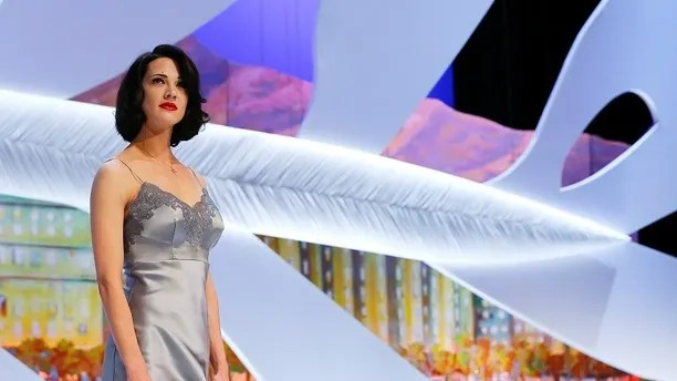 Actress Asia Argento stands on stage during the closing ceremony of the 66th Cannes Film Festival in Cannes May 26, 2013.                REUTERS/Yves Herman (FRANCE  - Tags: ENTERTAINMENT)   - LR2E95Q1LGIWO