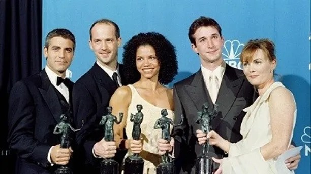 "Cast members of the television show ""ER"" pose with their awards for best ensemble of a dramatic television series, February 22, in Los Angeles. From L to R - George Clooney, Anthony Edwards, Gloria Reuben, Noah Wyle, and Laura Innes.  SAG AWARDS - RP1DRIDAPLAC"