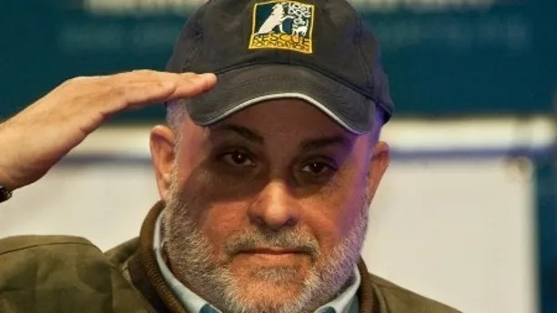 """Conservative radio host Mark Levin acknowledges the crowd after speaking at a """"Cut Spending Now"""" rally at the conservative Americans for Prosperity """"Defending the American Dream Summit"""" in Washington on Nov. 5, 2011. (NICHOLAS KAMM/AFP/Getty Images)"""