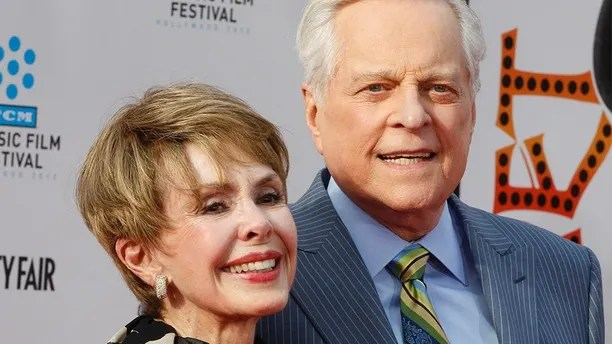 "Actress Barbara Rush (L) arrives with TCM host Robert Osborne at the world premiere of the 40th anniversary restoration of the film ""Cabaret"" during the opening night gala of the 2012 TCM Classic Film Festival in Hollywood, California  April 12, 2012.  REUTERS/Fred Prouser  (UNITED STATES - Tags: ENTERTAINMENT) - GM1E84D149I01"