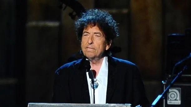 """FILE - In this Feb. 6, 2015 file photo, Bob Dylan accepts the 2015 MusiCares Person of the Year award at the 2015 MusiCares Person of the Year show in Los Angeles. Dylan, the winner of this year's Nobel Prize in literature declined the invitation to the Dec. 10 2016 prize ceremony and banquet, pleading other commitments. But the Nobel Foundation said Monday that Dylan has written a """"speech of thanks"""" that will be read by a yet-to-be-decided person at the lavish banquet in Stockholm's City Hall. (Photo by Vince Bucci/Invision/AP, File)"""