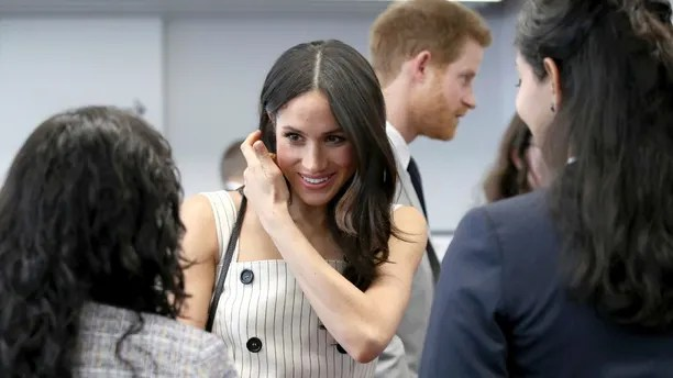 Meghan Markle attends a reception with Britain's Prince Harry for the Commonwealth Youth Forum at the Queen Elizabeth II Conference Centre, London, during the Commonwealth Heads of Government Meeting, Wednesday April 18, 2018. (Yui Mok/Pool via AP)