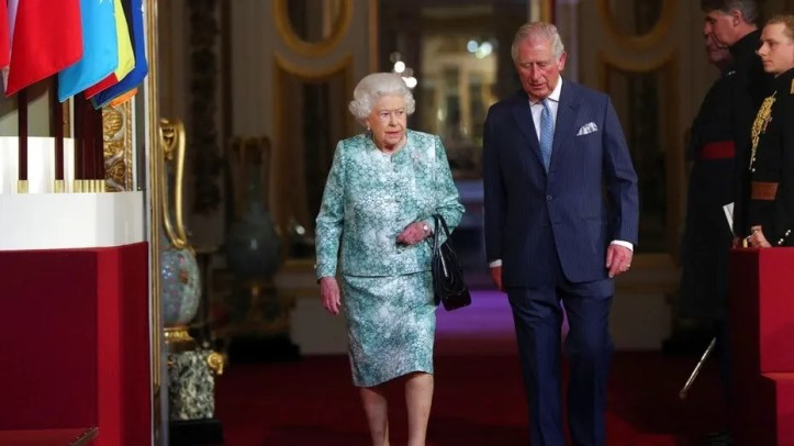 Britain's Queen Elizabeth II and Prince Charles arrive for the formal opening of the Commonwealth Heads of Government Meeting at Buckingham Palace in London, Thursday April 19, 2018. (Jonathan Brady/Pool via AP)