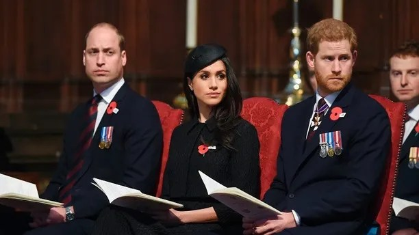 Britain's Prince William, left, Prince Harry and Meghan Markle attend a Service of Thanksgiving and Commemoration on ANZAC Day at Westminster Abbey in London, Wednesday, April 25, 2018. (Eddie Mulholland/Pool via AP)
