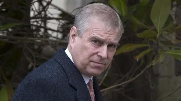 Britain's Prince Andrew leaves after attending the Easter Sunday service at St Georges Chapel at Windsor Castle in southern England April 5, 2015. REUTERS/Neil Hall - GF10000050236