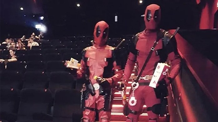 A 'Deadpool' fan wearing the superhero's costume was arrested with his friend while on the way to see the new comic-book inspired movie.