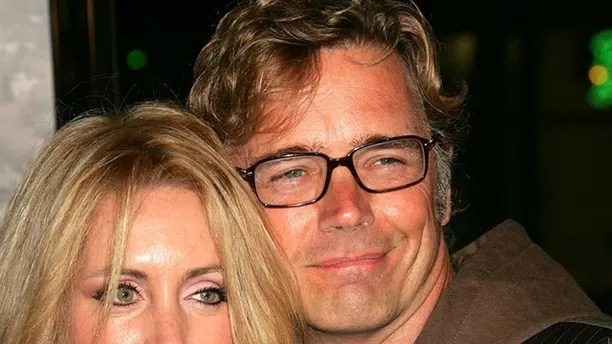 John Schneider and wife Elly Castle at the premiere for North Country at Grauman's Chinese Theaterin Hollywood, California in 2005.