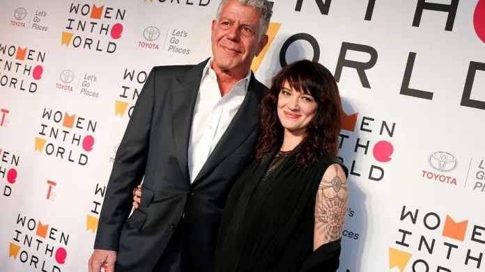 Anthony Bourdain poses with Italian actor and director Asia Argento for the Women In The World Summit in New York City, U.S., April 12, 2018.