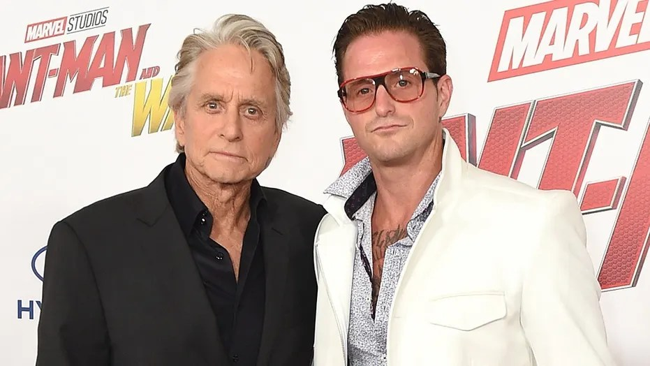 "Michael Douglas, left, and Cameron Douglas arrive at the Los Angeles premiere of ""Ant-Man and the Wasp"" at El Capitan Theatre on Monday, June 25, 2018. (Photo by Jordan Strauss/Invision/AP)"