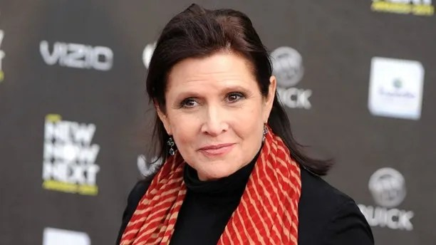 """FILE - This April 7, 2011 file photo shows Carrie Fisher at the 2011 NewNowNext Awards in Los Angeles. Lucasfilm, the company behind """"Star Wars,"""" says there are no plans to digitally recreate the late Carrie Fisher to play Princess Leia in future episodes of the movie saga. The Disney-owned Lucasfilm made the rare foray into the world of """"Star Wars"""" speculation Friday, Jan. 13, 2017 by issuing the statement denying any plans to digitize Fisher, who died Dec. 27. (AP Photo/Chris Pizzello, File)"""