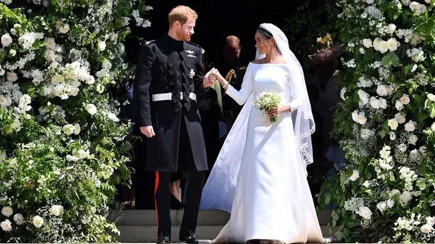 WINDSOR, UNITED KINGDOM - MAY 19:  Prince Harry and Meghan Markle leave St George's Chapel through the west door after their wedding in St George's Chapel at Windsor Castle on May 19, 2018 in Windsor, England. (Photo by Ben Birchall - WPA Pool/Getty Images)