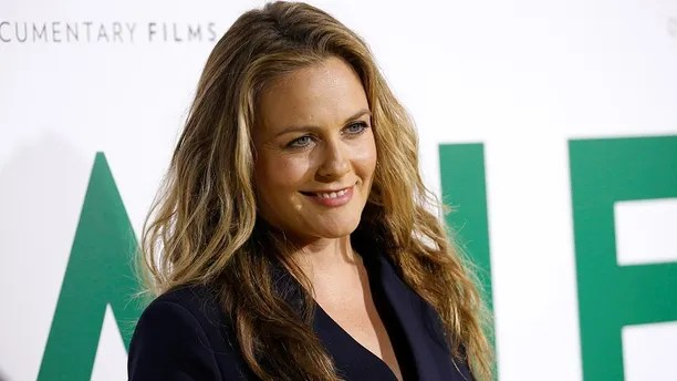 Actor Alicia Silverstone poses at the premiere for the documentary