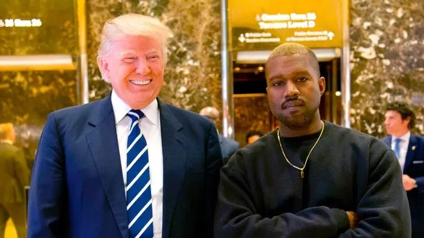 """FILE - In this Dec. 13, 2016, file photo, then-President-elect Donald Trump and Kanye West pose for a picture in the lobby of Trump Tower in New York. Trump is tweeting his thanks to rap superstar Kanye West for his recent online support. Trump wrote, """"Thank you Kanye, very cool!� in response to the tweets from West, who called the president """"my brother.� West tweeted a number of times Wednesday expressing his admiration for Trump, saying they both share """"dragon energy.� The rap star also posted a photo of himself wearing Trump's campaign """"Make America Great Again� hat. (AP Photo/Seth Wenig, File)"""