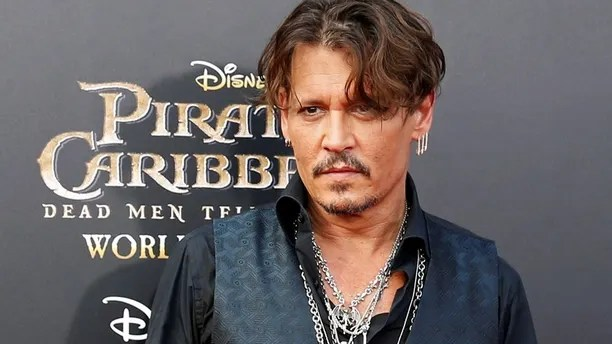 """Actor Johnny Depp arrives on the red carpet for the global premiere of the film """"Pirates of the Caribbean: Dead Men Tell No Tales"""", in Shanghai, China May 11, 2017."""