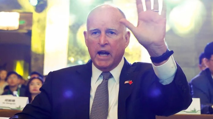 FILE 2017: California Governor Jerry Brown attends International Forum on Electric Vehicle Pilot Cities and Industrial Development in Beijing.