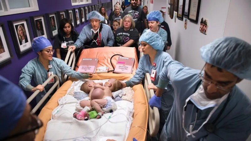 Hospital personnel wheel conjoined twins, Anna and Hope Richards, to surgery to separate the toddler girls on Jan. 13. The girls who were born in 2016 were conjoined at the chest and abdomen.