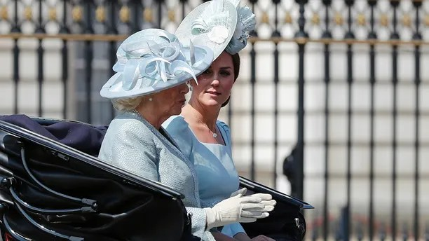 Britain's Kate, the Duchess of Cambridge, right, and Camilla, the Duchess of Cornwall ride in a carriage to attend the annual Trooping the Colour Ceremony in London, Saturday, June 9, 2018.(AP Photo/Frank Augstein)