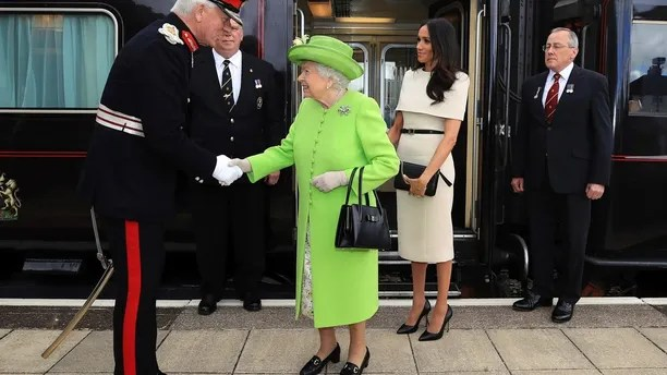 Britain's Queen Elizabeth II and Meghan, the Duchess of Sussex arrive by Royal Train at Runcorn Station, north west England, Thursday June 14, 2018. (Peter Byrne/Pool via AP)
