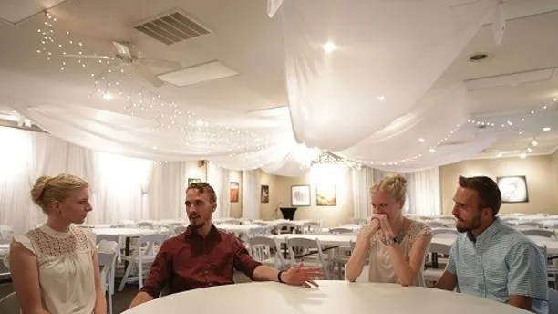 From left, Kassie Bevier, fianc Nicholas Lewan, Krissie Bevier and fianc Zack Lewan, react as they talk about their relationships and growing up as identical twins, Sunday, July 29, 2018, in Grass Lake. The identical twin couples are set to be married Friday, Aug. 3, 2018 and Saturday, Aug. 4, 2018. (Nikos Frazier /Jackson Citizen Patriot via AP)