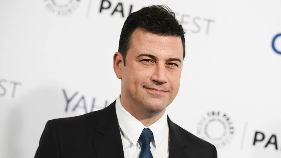 """FILE -- In this March 8, 2015, file photo, Jimmy Kimmel arrives at the 32nd Annual Paleyfest : """"Scandal"""" held at The Dolby Theatre in Los Angeles."""