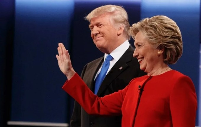 Republican presidential candidate Donald Trump, left, stands with Democratic presidential candidate Hillary Clinton before the first presidential debate at Hofstra University, Monday, Sept. 26, 2016, in Hempstead, N.Y. (AP Photo/ Evan Vucci)