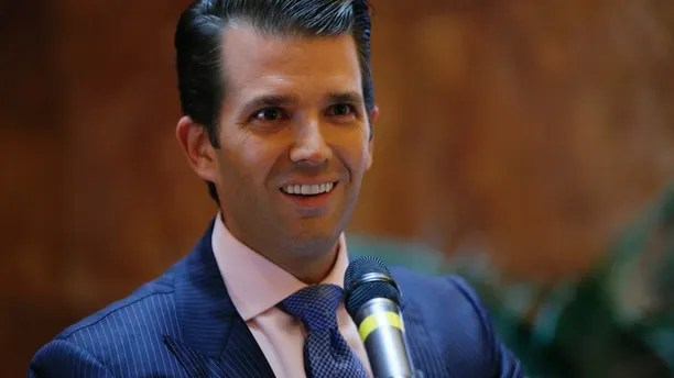 "FILE - In this June 5, 2017, file photo, Donald Trump Jr., executive vice president of The Trump Organization, announces that the family's company is launching a new hotel chain inspired by his and brother Eric's Trump's travels with their father's campaign at Trump Tower in New York. Trump Jr. shared a video on July 8, 2017, of an edited clip of the 1986 military thriller ""Top Gun†in which President Donald Trump's face is superimposed over Tom Cruise's character as he shoots down a Russian jet with a CNN logo on it. (AP Photo/Kathy Willens, File)"