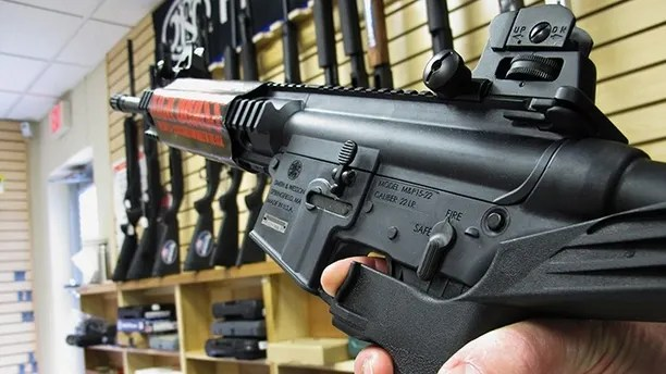 """FILE - In this Feb. 1, 2013, file photo, an employee of North Raleigh Guns demonstrates how a """"bump"""" stock works at the Raleigh, N.C., shop. The gunman who unleashed hundreds of rounds of gunfire on a crowd of concertgoers in Las Vegas on Monday, Oct. 2, 2017, attached what is called a """"bump-stock"""" to two of his weapons, in effect converting semiautomatic firearms into fully automatic ones. (AP Photo/Allen Breed, File)"""