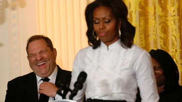 Film producer and studio executive Harvey Weinstein laughs at remarks directed at him by U.S. first lady Michelle Obama as she hosts a workshop at the White House for high school students about careers in film in Washington November 8, 2013. At right is actress Whoopi Goldberg (obscured).  REUTERS/Kevin Lamarque  (UNITED STATES - Tags: POLITICS ENTERTAINMENT) - GM1E9B90A3Z01