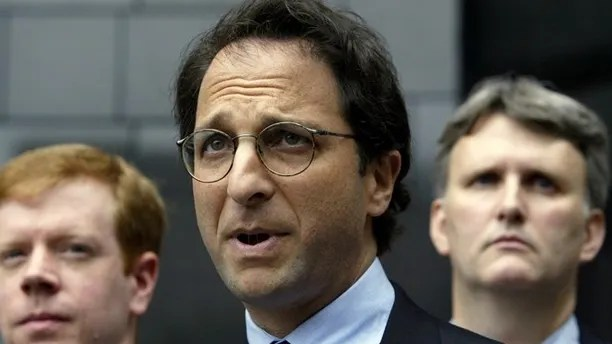 Federal prosecutor Andrew Weissmann (C) is flanked by FBI agents as hespeaks to the press outside the federal courthouse in Houston, Texas about the latest round of indictments stemming from the collapse of Enron, May 1, 2003. Also Lea Fastow, wife of Enron Chief Financial Officer Andrew Fastow, is expected to be indicted on tax and mail fraud. REUTERS/Jeff Mitchell JM/ME - RTRMRJX