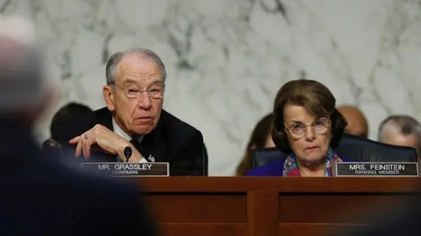 Senate Judiciary Committee Chairman Chuck Grassley, R-Iowa, left, and ranking member Sen. Dianne Feinstein, D-Calif., look to Attorney General Jeff Sessions as he testifies before the Senate Judiciary Committee on Capitol Hill in Washington, Wednesday, Oct. 18, 2017. (AP Photo/Carolyn Kaster)