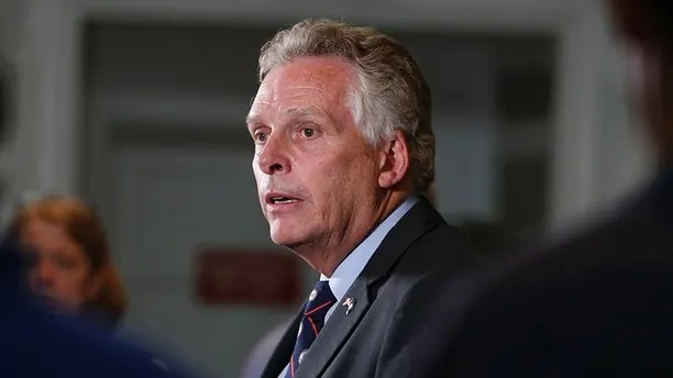 FILE- In this Aug. 12, 2017, file photo, Virginia Gov. Terry McAuliffe addresses a news conference concerning the white nationalist rally and violence in Charlottesville, Va. A group of Chinese investors is suing McAuliffe over his past work for troubled electric car maker GreenTech Automotive. The investors filed a lawsuit in Fairfax County last week accusing McAuliffe and Hillary Clinton's brother Anthony Rodham of milking their political connections to perpetuate a $120 million scam. (AP Photo/Steve Helber)
