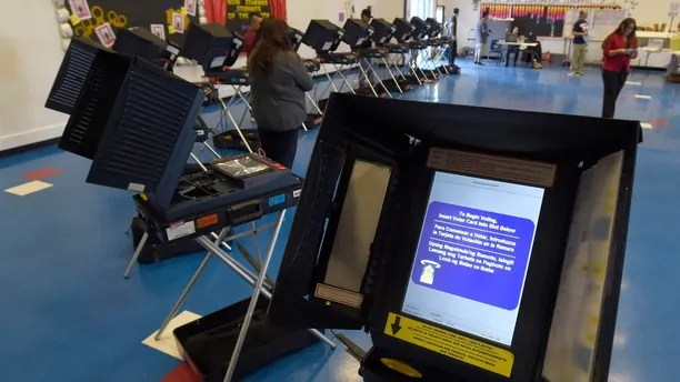 Voting machines are set up for people to cast their ballots during voting in the 2016 presidential election at Manuel J. Cortez Elementary School in Las Vegas, Nevada, U.S November 8, 2016.  REUTERS/David Becker - HT1ECB81RBICM