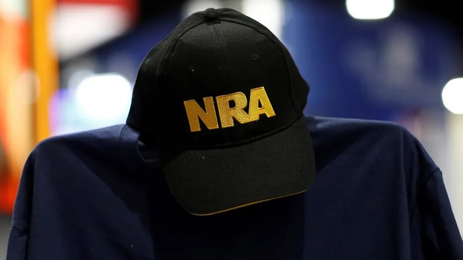 A cap and shirt are displayed at the booth for the National Rifle Association (NRA) at the Conservative Political Action Conference (CPAC) at National Harbor, Md., Feb. 23, 2018.