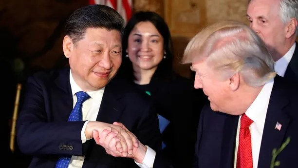 In this April 6, 2017 file photo, President Donald Trump, right, shakes hands with Chinese President Xi Jinping during a dinner at Mar-a-Lago, in Palm Beach, Fla.